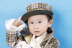 garçon asiatique dans la robe de tartan Photos stock