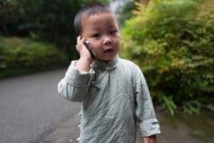 Garçon au téléphone Image libre de droits