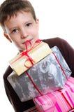 Garçon avec des cadeaux Photo stock