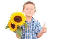 Garçon avec des fleurs Photographie stock libre de droits