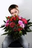 Garçon avec des fleurs Photos stock