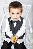Garçon avec des raisins Photographie stock