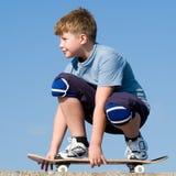 Garçon avec la planche à roulettes Photo libre de droits