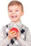 Garçon avec la pomme rouge fraîche Photographie stock