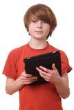 Garçon avec la tablette Image libre de droits