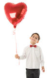Garçon avec le ballon rouge Photo stock