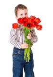 Garçon avec le bouquet des tulipes Image stock