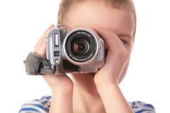 Garçon avec le caméscope Photos libres de droits