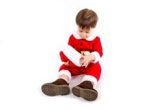 Garçon avec le costume de Santa photographie stock