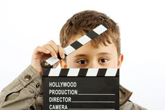 Garçon avec le panneau de clapet de film Photographie stock