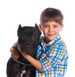 Garçon avec son Pit Bull Terrier Image libre de droits