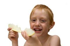 Garçon avec un melon Photographie stock libre de droits
