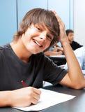 Garçon d'école de sourire Photographie stock libre de droits
