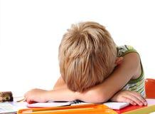 Garçon d'école fatigué Photos stock