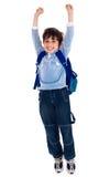 Garçon d'école soulevant ses bras dans la joie Photographie stock libre de droits