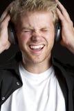 Garçon d'écouteurs Photographie stock