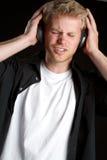 Garçon d'écouteurs Images stock