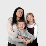 Garçon d'étreinte de femme et de fille petit Images libres de droits