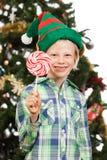 Garçon d'Elf tenant la lucette Image stock