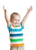 Garçon d'enfant avec des mains vers le haut sur le fond blanc images stock