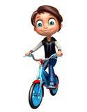 Garçon d'enfant avec la bicyclette Photos libres de droits