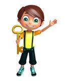 Garçon d'enfant avec la clé Photographie stock