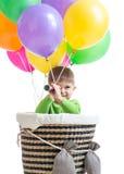 Garçon d'enfant sur le ballon à air chaud d'isolement Photos libres de droits