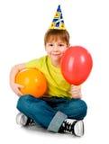 Garçon dans des chapeaux d'anniversaire Photographie stock