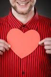 Garçon dans l'amour avec le coeur rouge Photographie stock libre de droits