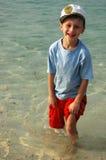 Garçon dans l'eau. Images libres de droits