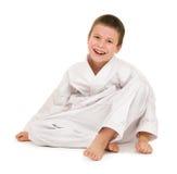 Garçon dans l'habillement pour des arts martiaux photographie stock