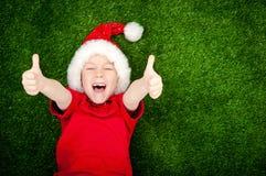 Garçon dans le chapeau de Santa images stock