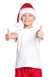 Garçon dans le chapeau de Santa Photographie stock libre de droits