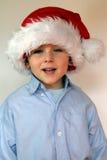garçon dans le chapeau de Santa Photos stock