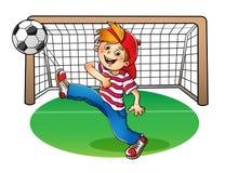 Garçon dans un chapeau rouge donnant un coup de pied un ballon de football illustration de vecteur