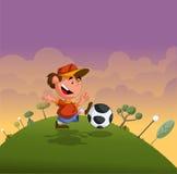 Garçon de dessin animé jouant avec la bille de football Photo stock