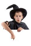 Garçon de l'adolescence dans le magicien de costume de carnaval d'isolement en fonction Photographie stock libre de droits