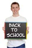 Garçon de l'adolescence de nouveau au signe d'école Image libre de droits