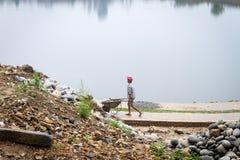 Garçon de Nepali aux travaux de construction Photos libres de droits
