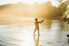 Garçon de pêcheur avec la rotation Photo libre de droits