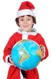 Garçon de Santa avec le globe Photographie stock