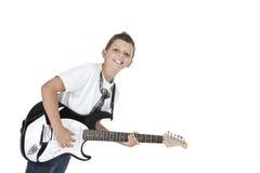 Garçon de sourire avec la guitare électrique Photos libres de droits