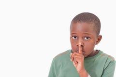 Garçon demandant le silence Photos stock