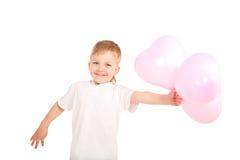 Garçon donnant des ballons de coeur Images stock