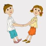 Garçon drôle et fille tenant des mains Photo libre de droits