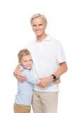 Garçon embrassant avec le grand-père Photo libre de droits