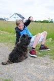 Garçon et chien Photos stock
