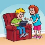 Garçon et fille à l'aide d'une Tablette de Digital d'écran tactile Photo libre de droits