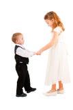 Garçon et fille apprenant à danser Image stock