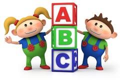 Garçon et fille avec des blocs d'ABC Image stock